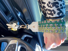 Kelly Wynne Keep on Cruisin Keychain in White Review