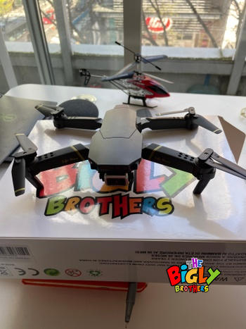 The Bigly Brothers The Bigly Brothers E58 Pro X: 4k HD Drone Dual Camera Edition,Black FPV Drone with Camera and carrying Case plus an additional 1200mAh Battery. Up to 30 minutes of flight. Review