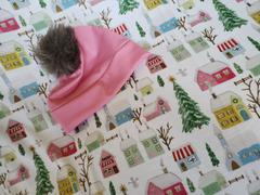audrey-and-bear Pink Winter Village | Holiday Swaddle & Hat Set Review