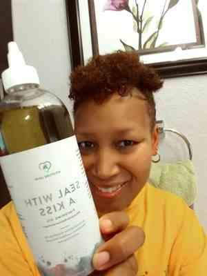 LaTonya R. verified customer review of Seal with a Kiss Finishing Oil