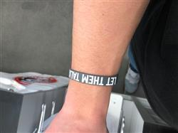 Brady W. verified customer review of LET THEM TALK Wristband