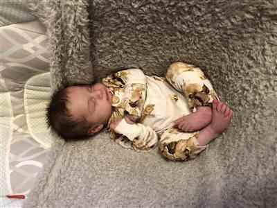 Breanna Bliss  verified customer review of Reese Floral Ruffled Henley Romper