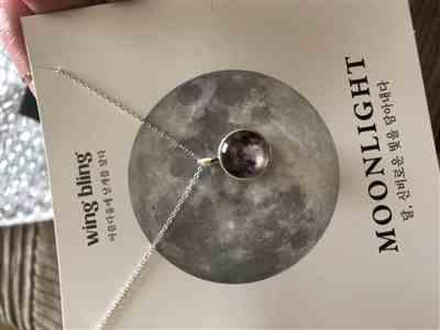 Dianne H. verified customer review of WHITE MOON Necklace (glow in the dark)