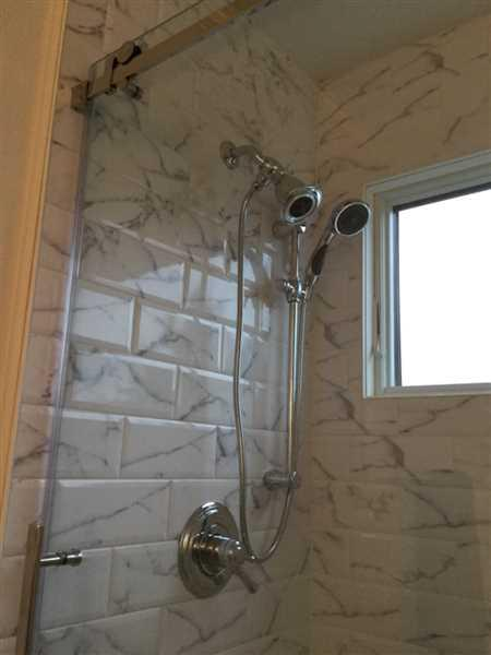 FaucetList.com Delta Cassidy Chrome Shower Faucet System w/ Showerhead and Hand Shower DSP0764V Review
