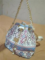 Poppy Montez verified customer review of Bohemian Drawstring Bucket Bag