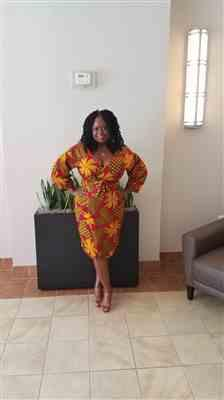 Samantha F. verified customer review of Bisi African Print Pleated Sleeve Wrap Dress (Magenta/Yellow Pinwheels)