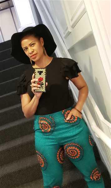 Kee verified customer review of Safina African Print Stretch Fitted High-Waisted Pants (Turquoise Orange Swirls)