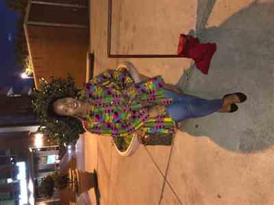 Tiffany Williams verified customer review of Tumela African Print High low Button up Shirt (Raspberry Yellow Kente)