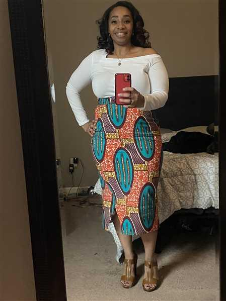 Erica verified customer review of Tavia African Print Stretch Midi Skirt (Orange Teal Ovals)