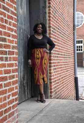 Karen  verified customer review of Tavia Faux African Print Stretch Midi Skirt (Red Yellow Leaves)