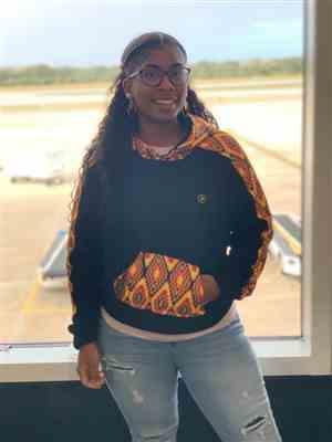 Theodore Byfield verified customer review of Wekesa African Print Color Blocked Crop Hoodie ( Orange Yellow Kente)