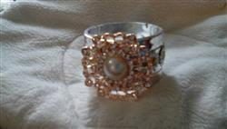 Marilyn B. verified customer review of ROSE GOLD FLOWER RHINESTONE PEARL BROOCH