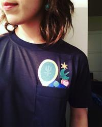 Amanda V. verified customer review of Glitter Neptune Pocket Tee