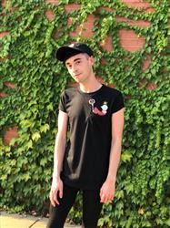 Skyler L. verified customer review of Glitter Pluto Pocket Tee