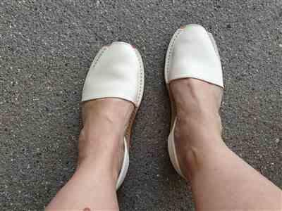 Anonymous verified customer review of Ivory White leather