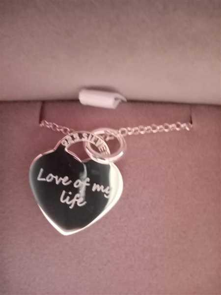 Laura Houston  verified customer review of Engraved Handprint Or Footprint Heart Necklace, Two Prints And One Name