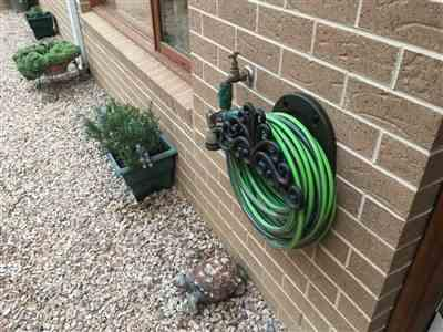 Neil F. verified customer review of Decorative Hose Hanger